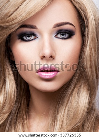Portrait of pretty attractive young woman with bright makeup. Beautiful  brown-haired.  - stock photo