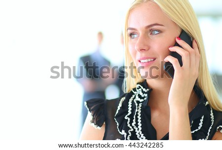 Portrait of pretty beautiful business woman on the phone with a modern building  - stock photo