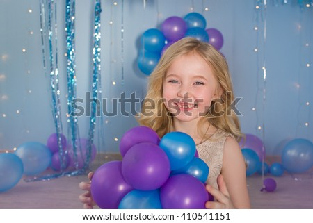 Portrait of Pretty blonde little girl with a color balloons in a hands - stock photo