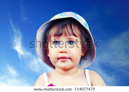 Portrait of pretty blue-eyed girl in a hat - stock photo