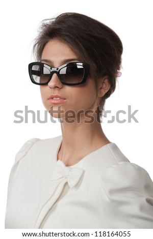 Portrait of pretty brunette in sunglasses posing in the studio on a white background