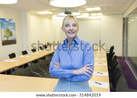 Portrait of pretty business woman in meeting room