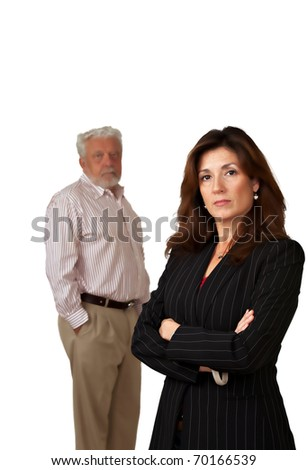 Portrait of pretty business woman with sad looking mature man in background.  Isolated on white. - stock photo