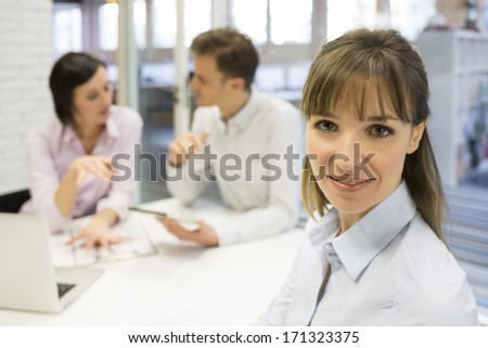 Portrait of pretty businesswoman during a meeting, looking camera