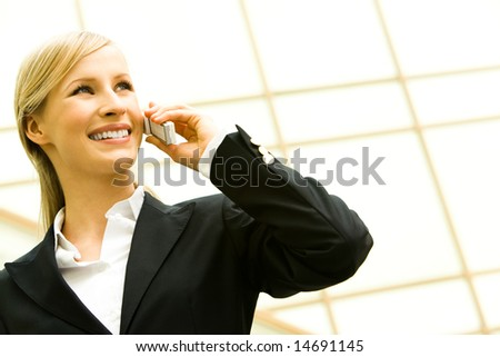 Portrait of pretty businesswoman making her career - speaking by phone - stock photo