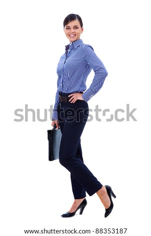 Portrait of pretty businesswoman posing before camera in isolation