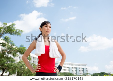 Portrait of pretty determined Vietnamese jogger - stock photo