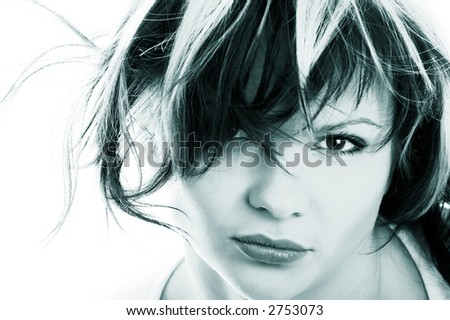 Portrait of  pretty dishevelled girl on white background - stock photo