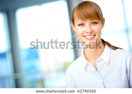 Portrait of pretty female looking at camera with smile - stock photo