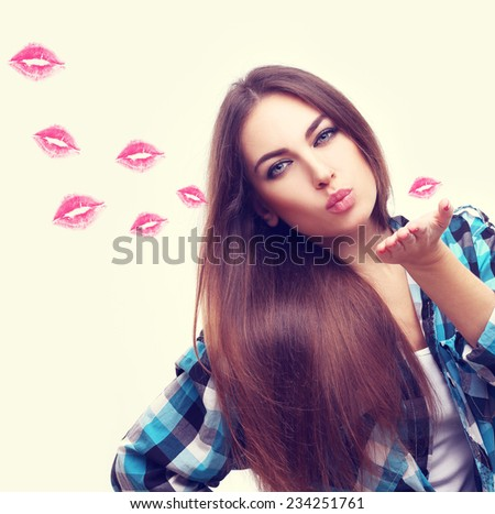 Portrait of pretty  girl , blowing kiss at the camera. - stock photo