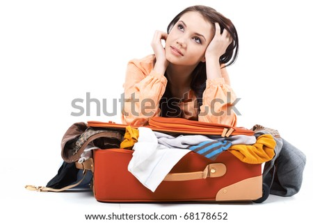 Portrait of pretty girl dreaming about vacation - stock photo