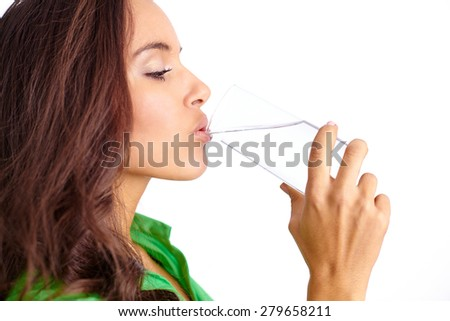 Portrait of pretty girl drinking water from glass - stock photo