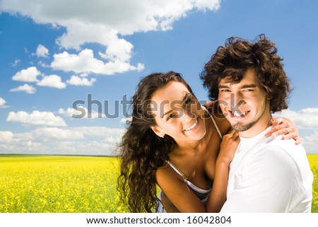 Portrait of pretty girl embracing her boyfriend at summertime - stock photo