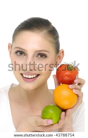 Portrait of pretty girl holding different fruits
