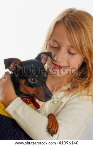 Portrait of pretty girl holding dog - stock photo