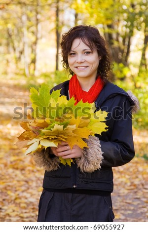 Portrait of pretty girl in coat at autumn park - stock photo