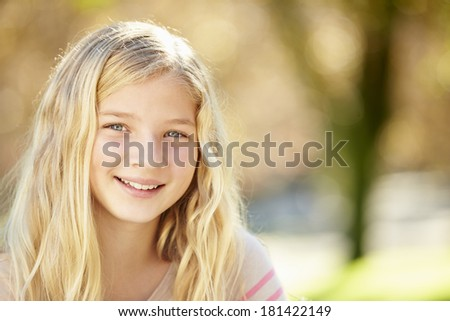Portrait Of Pretty Girl In Countryside - stock photo
