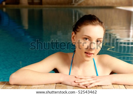 Portrait of pretty girl in swimming pool - stock photo