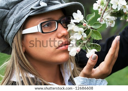 portrait of pretty girl in the flowering garden; shallow DOF