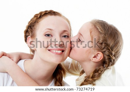 Portrait of pretty girl kissing her mother