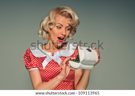 portrait of pretty girl with dolly-bag in the retro style - stock photo