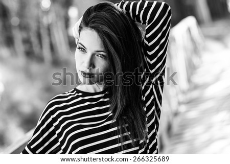 Portrait of pretty girl with green eyes wearing casual clothes - stock photo