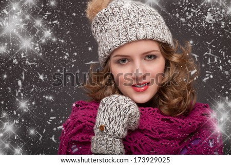 Portrait of pretty girls in the winter. Cute girl is happy to see snowflakes. With snow, Winter background