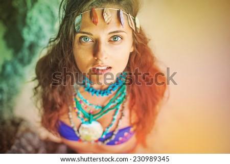 portrait of pretty hippie girl wearing handmade  jewelery - stock photo