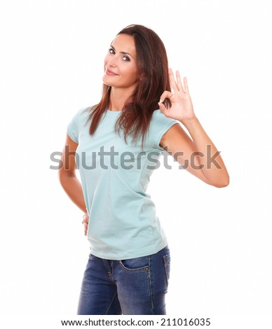 Portrait of pretty hispanic female on blue t-shirt with positive gesture smiling at you on isolated white background - stock photo