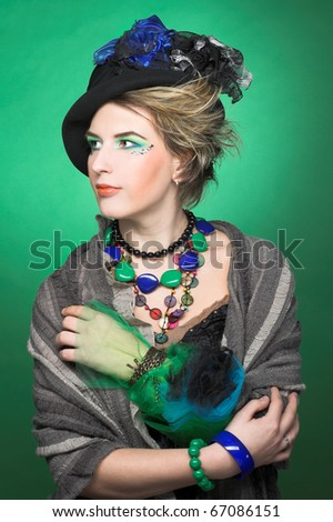 Portrait of pretty lady in vintage hat and with artistic make-up