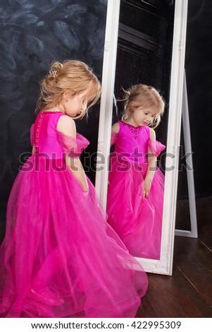 Portrait of pretty little girl in a beautiful dress.  - stock photo