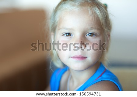 Portrait of pretty little girl in blue dress close-up. - stock photo