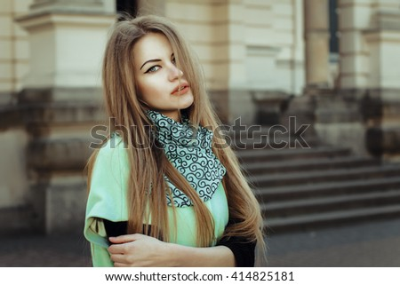 Portrait of pretty lovely woman at the street. Closeup shot - stock photo