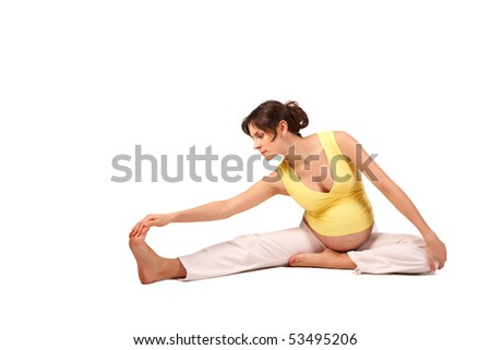 Portrait of pretty pregnant woman practicing physical exercise over white background - stock photo