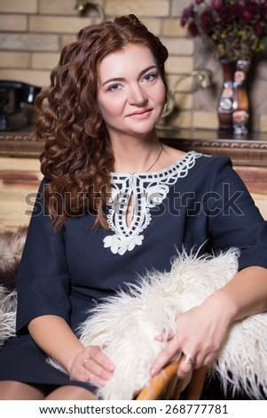 Portrait of pretty redhead woman in blue dress - stock photo