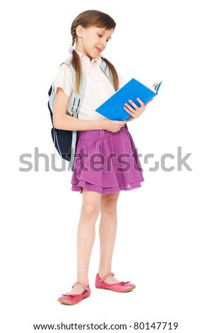 portrait of pretty schoolgirl reading book over white background
