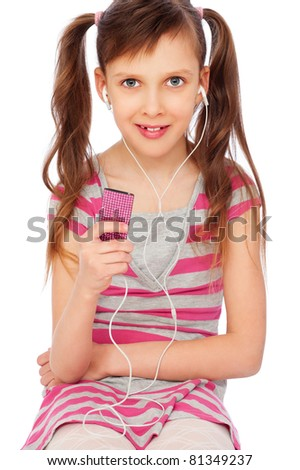 portrait of pretty smiley girl with personal stereo - stock photo