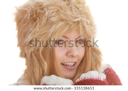 Portrait of pretty smiling fashionable woman. Happy gorgeous young girl in fur winter hat. Autumn fall fashion.