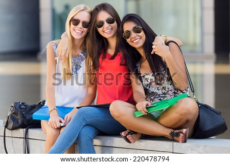 Portrait of pretty student girls having fun at the park after school