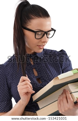 Portrait of pretty student with books and black framed glasses. - stock photo