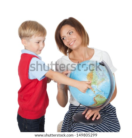 Portrait of pretty tutor and her pupil with a globe over white background