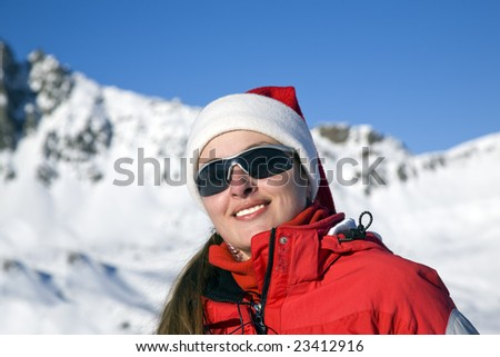 Portrait of pretty woman against a background of the mountains