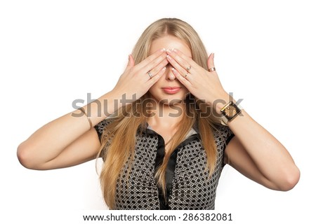 Portrait of pretty woman covers eyes by hands in See No Evil gesture - stock photo