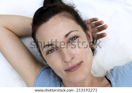 portrait of pretty woman lying and posing