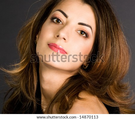 portrait of pretty woman on black background