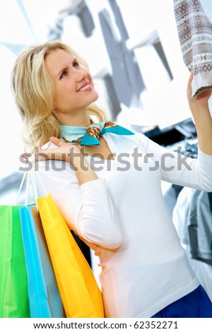 Portrait of pretty woman shopping for clothes - stock photo