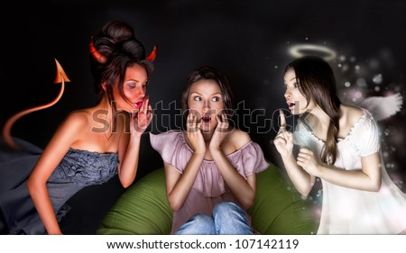 Portrait of pretty woman sitting at home. Angel and devil talking to her from different sides of picture. She is hesitating about decision - stock photo