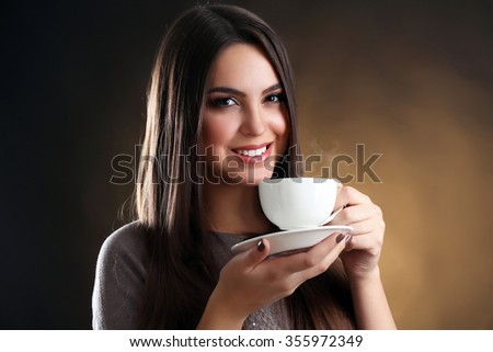 Portrait of pretty woman with cup of coffee - stock photo