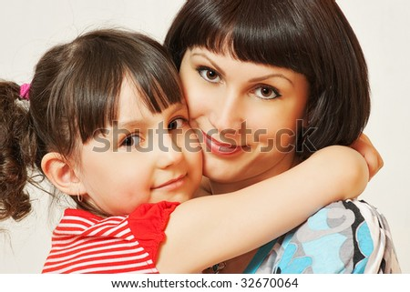 Portrait of pretty woman with her daughter.