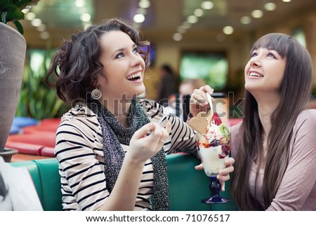 Portrait of pretty women talking and smiling - stock photo